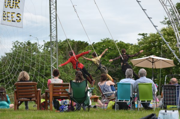 Eleni, Jess and Lisa perform in front of a picnicking audience at Longlands Farm on the Whitbourne Estate